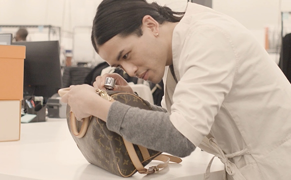 Kevin Ngo Inspects A Louis Vuitton Speedy Bag