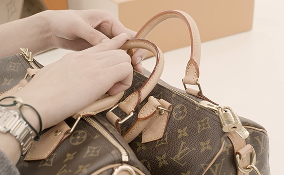 Kevin Ngo Inspecting The Materials Of A Louis Vuitton Speedy Bag