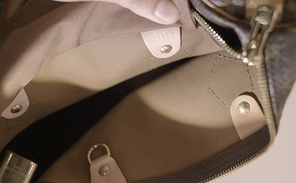 The Brand Stamp On A Louis Vuitton Speedy Bag