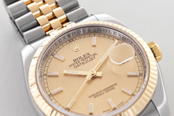 Rolex Datejust with focus on repeating Rolex text on rehaut ring