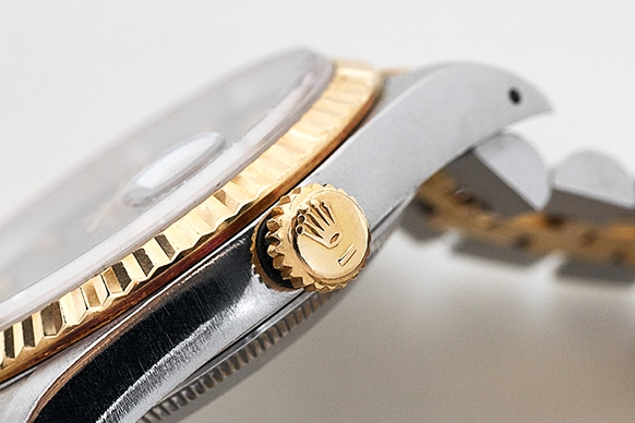 The bezel and crown of a Rolex Datejust