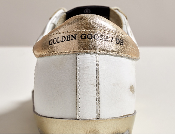 Golden Goose Sneakers brand stamp on counter