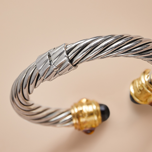 Closeup on hinge of a David Yurman cable bracelet