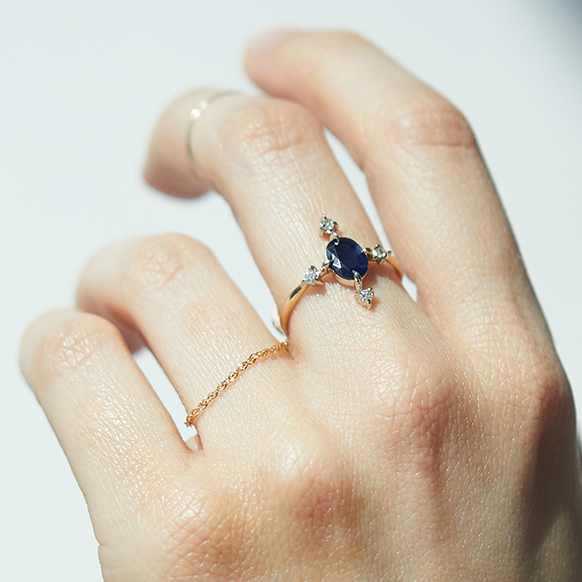 The RealReal x Catbird. Model wearing Sapphire Moonflower ring in gold with sapphire and diamonds, sustainable jewelry from upcycled collection