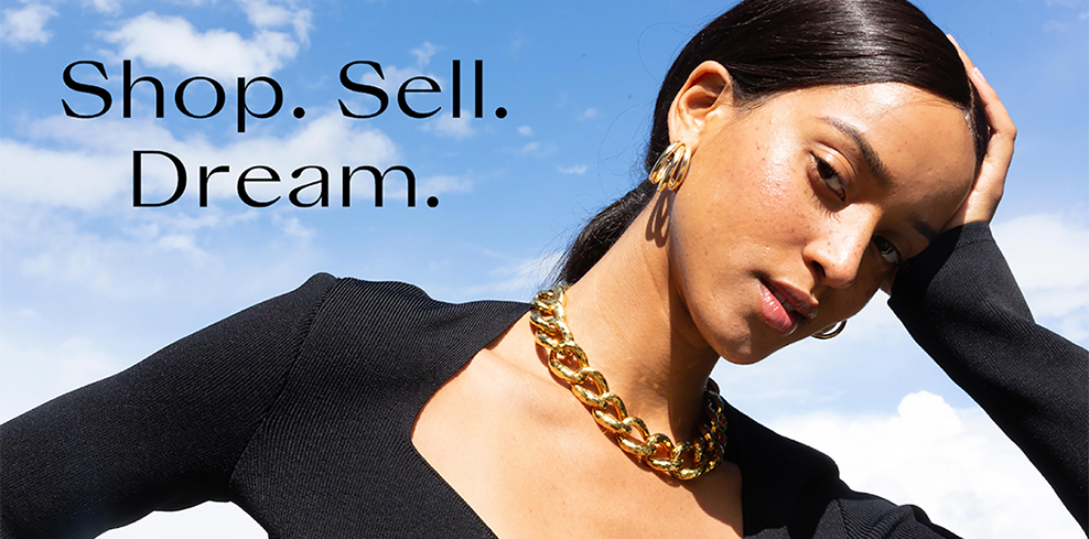 Shop. Sell. Dream. Model in gold necklace and hoop earrings and black sweetheart neckline top